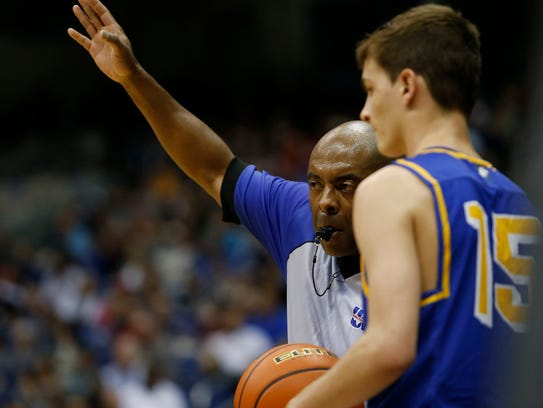 Referee Billy Gaines works the Class 3A boys basketball