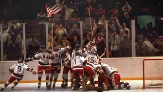 The U.S. hockey team pounces on goalie Jim Craig after a 4-3 victory against the Soviets in the 1980 Olympics on Feb. 22, 1980.