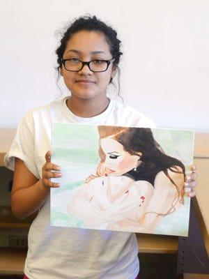 Aritzy Cruz with her untitled portrait.