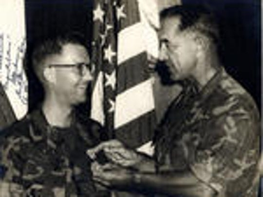 SSgt. Bryce Lockwood. left, is awarded a medal by Lt