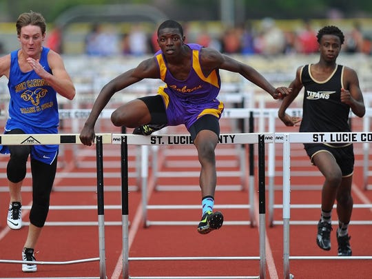ERIC HASERT/TREASURE COAST NEWSPAPERS Fort Pierce Central's Carl Elliott (center), shown competing in the 110 hurdles event in this file photo, will be one of the top athletes competing in the District 9-4A track meet Tuesday at Martin County High School.