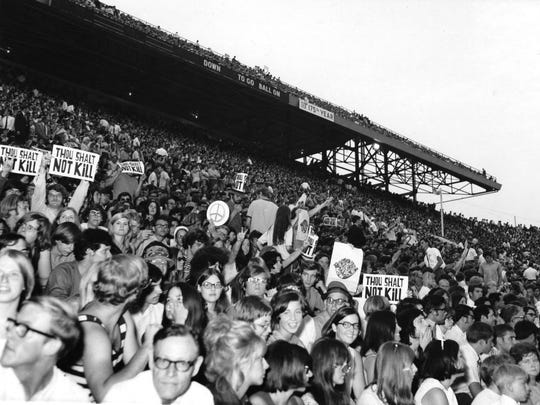In a May 28, 1970, photograph, protesters are seen during the Billy Graham East Tennessee Crusade at Neyland Stadium. Students were protesting the Vietnam War and the Kent State shootings, which happened earlier that month. (University of Tennessee Libraries)