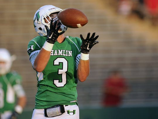 Thomas Metthe/Reporter-News Hamlin wide receiver Kyler Gann (3) pulls in a touchdown reception during the first quarter of Hamlin's 46-16 loss in the Action Zone Champions Classic on Thursday, Aug. 25, 2016, at Shotwell Stadium in Abilene.