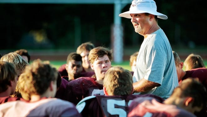 Collierville football coach Mike O'Neill talks with his team in 2015.