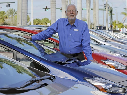 Earl Stewart, owner of a Toyota dealership, poses for a photo at his business in North Palm Beach, Fla.