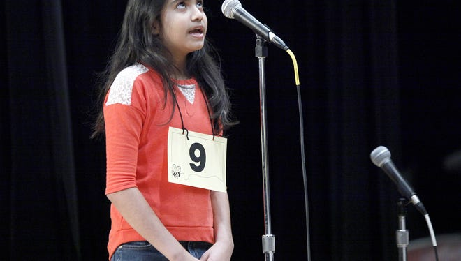 The 2014 Spelling Bee champion Risha Mehta from Burris Middle School competes at Cornerstone Center for the Arts in March 2014.