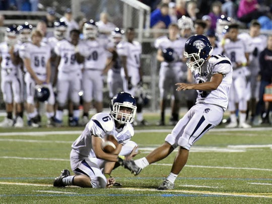 Chambersburg's Nazeer Taylor kicks the ball for a field goal earlier this season. Taylor had a wild ride during Friday's game against Cenral Dauphin East.