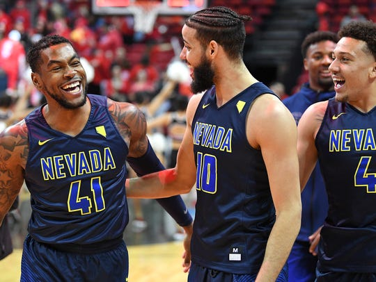 Wolf Pack guard Justin Brent (41) celebrates with forward