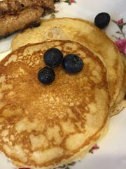 Pancakes can serve an army. Brush them with butter and keep them warm in the oven. Keep warm syrup and melted butter on the table.