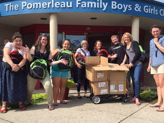 Lori Goldman, left, and Gillian Taylor, both from COTS, help deliver filled backpacks to the Boys & Girls Club of Burlington.