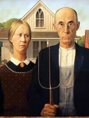 """Grant Wood's """"American Gothic"""", now on exhibit at the Des Moines Art Center."""