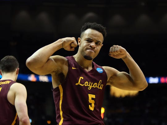 Loyola Ramblers guard Marques Townes (5) reacts during