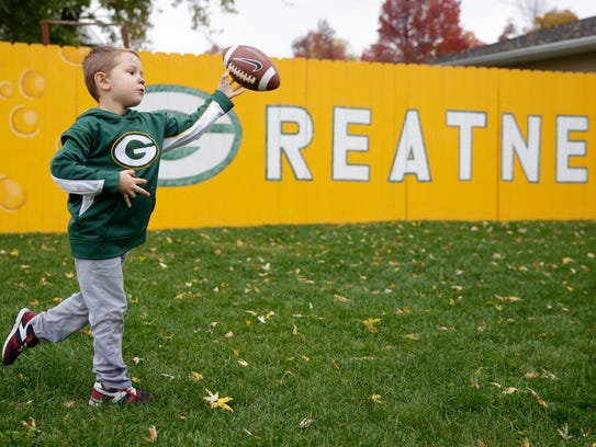 Charlie Knier, 4, of Pittsburgh, plays in yard at the