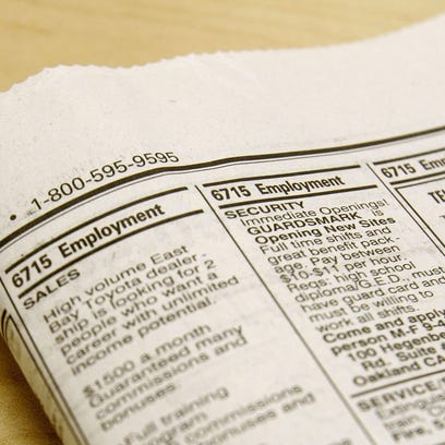 Employment opportunites are seen in a newspaper classified ad section.
