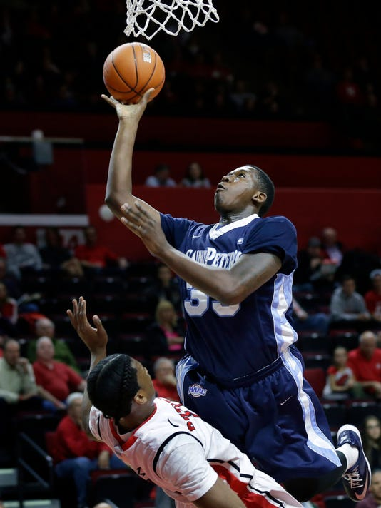 Saint Peter's Quadir Welton (35) takes a shot over Rutgers' Kadeem Jack (11) during the first half of an NCAA college basketball game Tuesday, Nov. 25, 2014, in Piscataway, N.J. (AP Photo/Mel Evans)