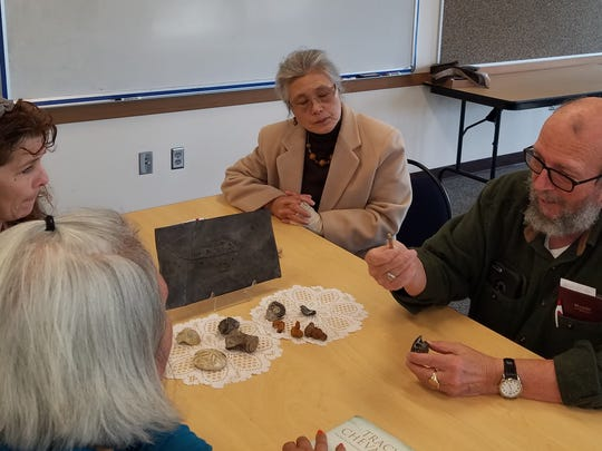 The book club at Stayton Library discusses their monthly