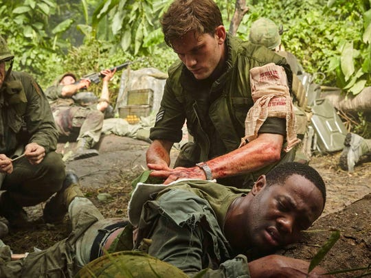 "Jeremy Irvine and SerDarius Blain, foreground, in ""The Last Full Measure."""