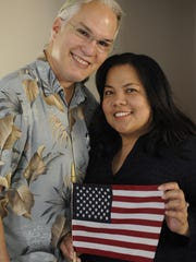 Michael Alvarez, 49, poses for a photograph with his wife, Lyn Mae Teves Alvarez, 38. She became an American citizen in 2013. They've been married seven years.