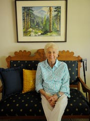 Pat Hillman, 86, sits on her grandmother's love seat