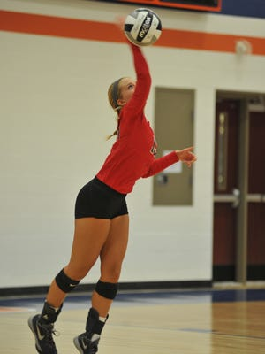Pleasant's Ashley James serves a ball at Galion recently. The Spartans finished as Mid Ohio Athletic Conference runners-up this season in volleyball.