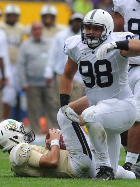 Penn State's Anthony Zettel celebrates a sack of UCF quarterback Pete DiNovo during last year's season opener at Croke Park Stadium. Zettel led the Nittany Lions last year with eight sacks and tied for the team lead with three interceptions.