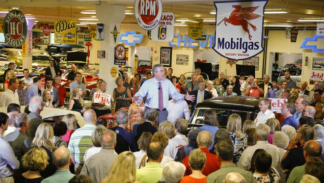 Former Florida Gov. Jeb Bush speaks during the Polk County GOP's Summer Sizzle at Dennis Albaugh's Classic Car Barn in Ankeny on Aug. 13.