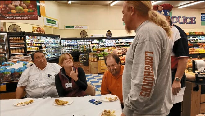 Rudy Fernandez (from left), Christal Faries, Mark Young and Frank Pain share a laugh after participating in the Easy As Pie pie-eating contest Friday at United Supermarkets on Willis Street. The competition marks the beginning of a yearly fundraiser for Meals on Wheels in which donors can get free pies for every $5 they give.