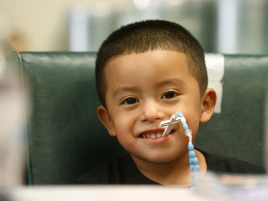 Franco, 4, is all smiles Friday at Annunciation House