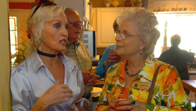 Artist Bonnie Siebert, left, talks with the Kemp Center for the Arts' Carlana Fitch during a visit to the artist's home in Woodson, Texas, in this file photograph. Fitch is retiring after 10 years at the Kemp, where she serves as chief executive officer. Fitch has spent three decades in arts business management, many of those years in Wichita Falls.
