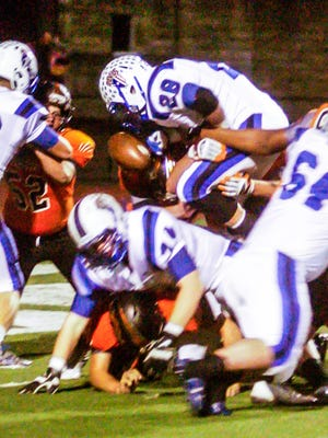 Marietta forces a fumble on the game's opening series in the Tigers' game against Zanesville on Friday night at Don Drumm Stadium.