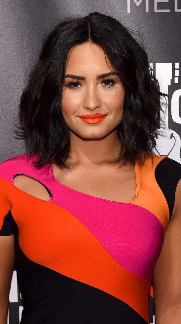 Demi Lovato expertly rocked an orange lip at A Night