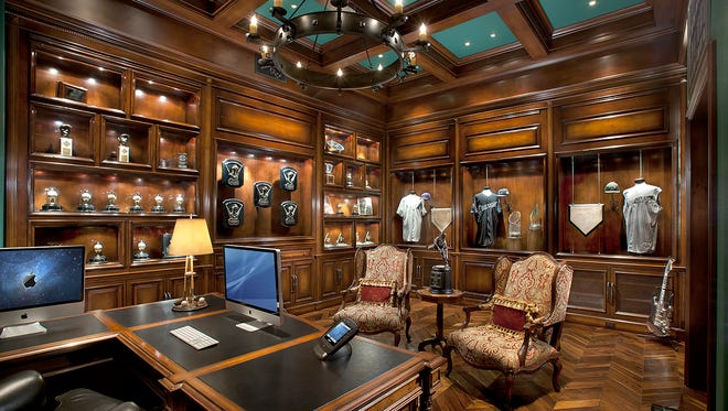 His office, with memorabilia including Randy Johnson's Cy Young awards, a World Series trophy replica and jerseys from his two no-hitters