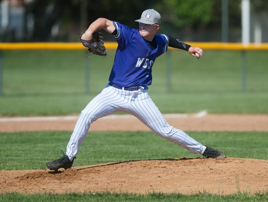 Cherry Hill West's Brian Robertson delivers a pitch