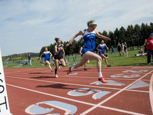 Lower Dauphin's Joely Helder wins the 100 meter dash ahead of Palmyra's Camryn Simpson.