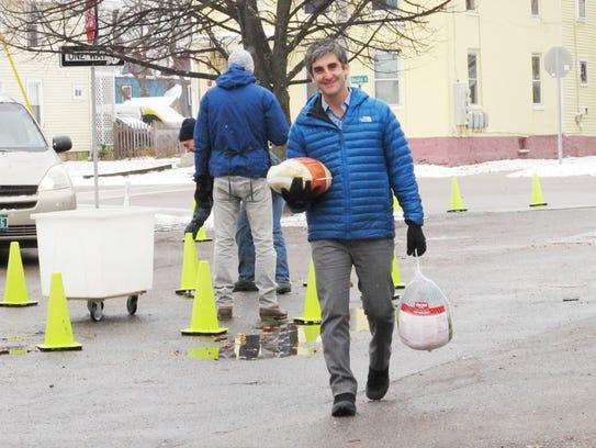 Burlington Mayor Miro Weinberger totes two turkeys