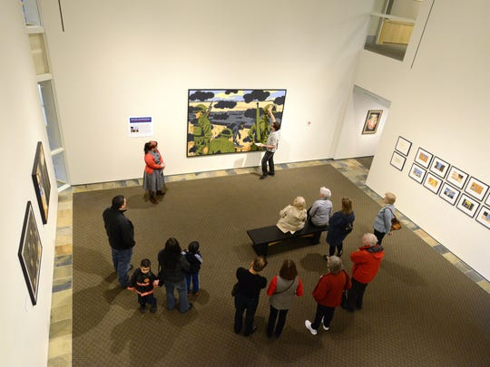 """Carlee Wright and Tom Mayhall Rastrelli lead a discussion about """"American Infamy #5"""" during a Tom and Carlee's C.A.F.E. (Community Arts for Everyone) event on Saturday, Jan. 31, 2015, at the Hallie Ford Museum of Art in Salem. C.A.F.E. is an ongoing series of interactive art events focusing on the arts and entertainment community."""