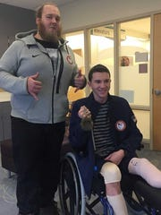 Lance Vargas, right, received a visit from USA Paralympian