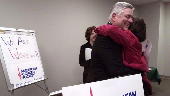 Keith Roberts gives driver Trish Ezell a hug before