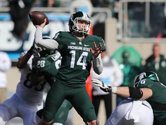 Michigan State quarterback Brian Lewerke passes during
