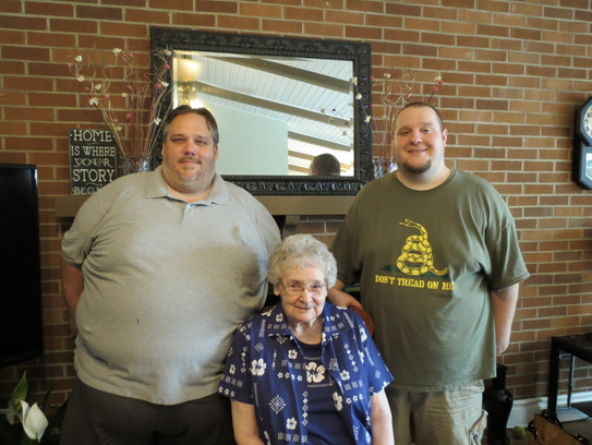 Brian McDonnel (left) stands with his brother and grandmother.