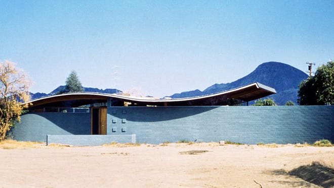 The Miles C. Bates house in Palm Desert as it originally looked. The house, with its roller-coaster roof of wood, was designed and built in the mid-1950s by mid-century architect Walter S. White and was recently auctioned by the city.