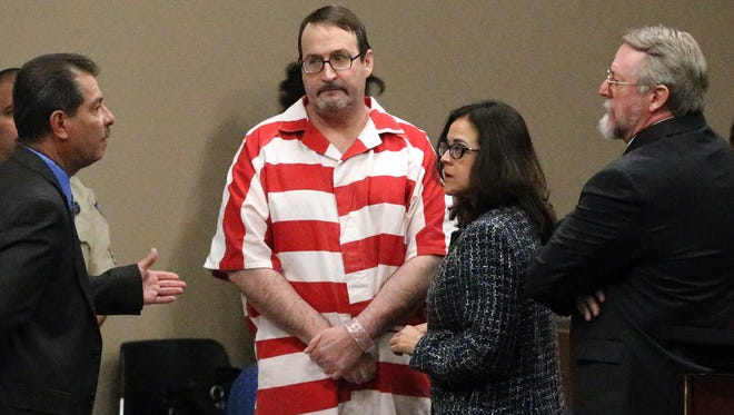 Sterling Ashcroft, center, stands after his sentencing Friday in the 34th District Court. Ashcroft was sentenced to 40 years in prison for two counts of murder in the 2014 deaths of Garett Hoff, 29, and Virginia Acosta, 55.