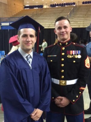 Trevor Gentry and the Marine who recruited him, SSgt. Abrams, at Trevor's graduation from Christiana High School.