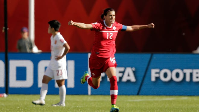 Canada forward Christine Sinclair (12) celebrates scoring a goal on a penalty kick against China goalkeeper Wang Fei (not pictured) during the second half in a Group A soccer match in the 2015 women's World Cup at Commonwealth Stadium.