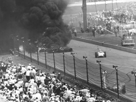 Jim McElreath (right) avoids a crash that killed drivers