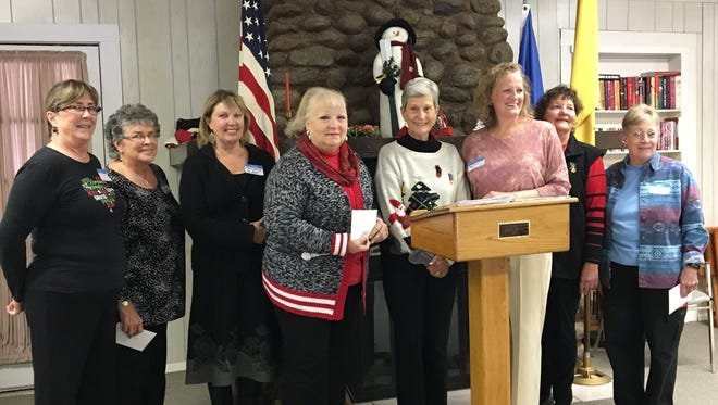 Annual donations from the Ruidoso Federated Woman's Club in December went to representatives  of local service organizations. From left are Sara Spoerri for Christian Services; Jennifer Chadwick for Hospice Foundation; Gwyn Kaitis for The NEST; Pat Scott for the Lincoln County Food Bank; Mary Van Orden, RFWC President; Nina Grunseth for the Humane Society of Lincoln County; and Marilyn Cokle and Susan Finch for Ski Apache Adaptive Sports.