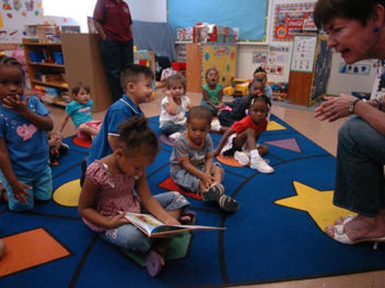 Volunteers read to students at Head Start.