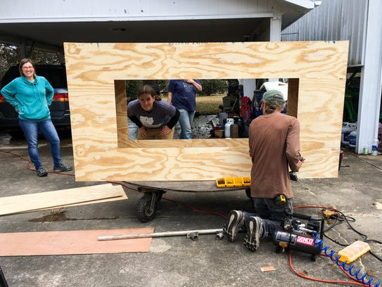 "Members of Krewe de Fou Que Tchu construct their ""float"""