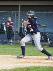Ketcham's Jessica Roe makes a hit during Monday's game against Arlington.