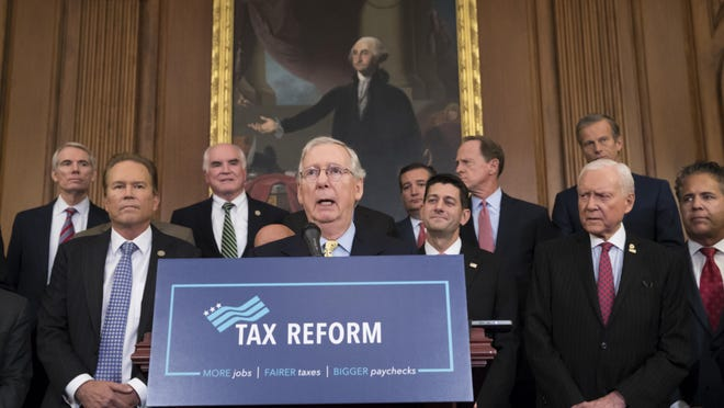 Senate Majority Leader Mitch McConnell, R-Ky., center, joins Speaker of the House Paul Ryan, R-Wis., and other GOP lawmakers to talk about the Republicans' proposed rewrite of the tax code for individuals and corporations on Sept. 27.